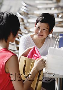 AsiaPix - Two women at cafe, with shopping bags