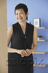 AsiaPix - Mature woman in black dress, smiling at camera