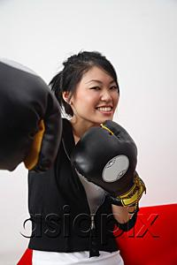 AsiaPix - Young woman with boxing gloves