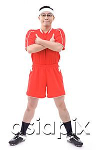 AsiaPix - Man in soccer uniform, arms crossed, smiling at camera