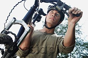 AsiaPix - Man carrying bicycle, low angle view