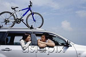 AsiaPix - Couple sitting in car, leaning out of the windows, bicycle on the roof