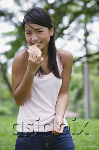 AsiaPix - Young woman outdoors, eating ice cream