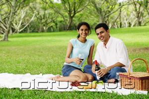 PictureIndia - Couple having a picnic, looking at camera, portrait