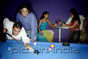 PictureIndia - Young adults playing pool and drinking beer