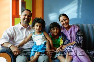 PictureIndia - Family with two children, smiling at camera